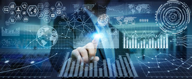 Businessman using digital charts for presentation. Businessman using futuristic screens with charts and graphics Stock Images
