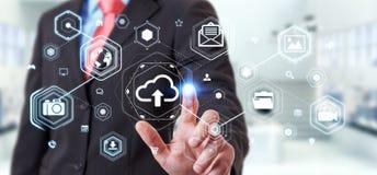 Businessman using digital cloud interface 3D rendering. Businessman on blurred background using digital cloud interface 3D rendering Stock Photo