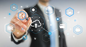 Businessman using digital cloud interface 3D rendering. Businessman on blurred background using digital cloud interface 3D rendering Royalty Free Stock Images