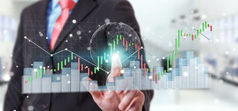 Businessman using digital 3D rendered stock exchange stats and c. Businessman on blurred background using digital 3D rendered stock exchange stats and charts Stock Image