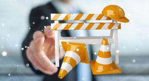 Businessman using digital 3D rendering under construction signs. Businessman on blurred background using digital 3D rendering under construction signs Royalty Free Stock Photos