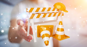 Businessman using digital 3D rendering under construction signs Stock Photography