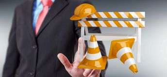 Businessman using digital 3D rendering under construction signs Royalty Free Stock Photos