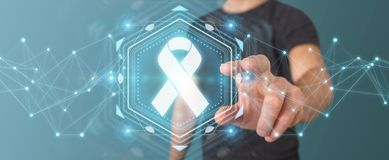 Businessman using digital ribbon cancer interface 3D rendering. Businessman on blurred background using digital ribbon cancer interface 3D rendering Royalty Free Stock Images