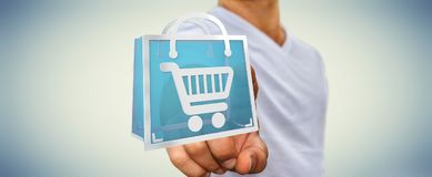 Businessman using digital shopping icons 3D rendering. Businessman on blurred background using digital shopping icons 3D rendering Stock Photography