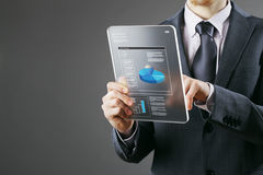 Businessman using a digital tablet Royalty Free Stock Image