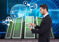 Businessman using digital tablet against data center in background Royalty Free Stock Image