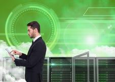 Businessman using digital tablet against server room Royalty Free Stock Images