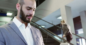 Businessman using digital tablet. At the airport stock footage