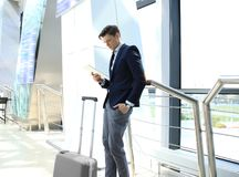 Businessman using digital tablet in airport departure lounge. Businessman using digital tablet in airport departure lounge royalty free stock image