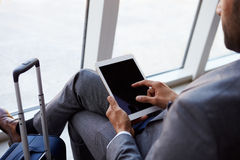 Businessman Using Digital Tablet In Airport Departure Lounge Royalty Free Stock Photo