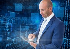 Businessman using digital tablet with binary codes against blue background Stock Photography
