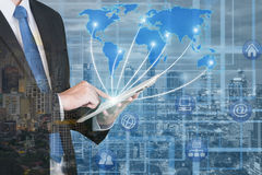 Businessman using digital tablet with blur city night Royalty Free Stock Photo
