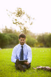 Businessman using a digital tablet Royalty Free Stock Images