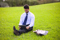 Businessman using a digital tablet Stock Image