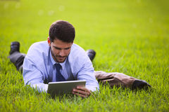 Businessman using a digital tablet Stock Images