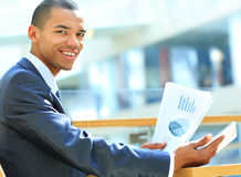 Businessman using digital tablet computer with documents Royalty Free Stock Photo