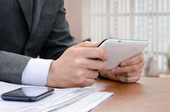 Businessman using digital tablet computer Stock Image