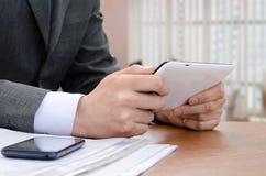 Businessman using digital tablet computer Stock Image