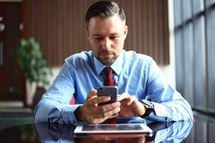 Businessman using digital tablet computer with modern mobile phone. New technologies for success workflow concept Stock Photography