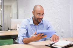 Businessman using digital tablet and diary at desk Stock Images