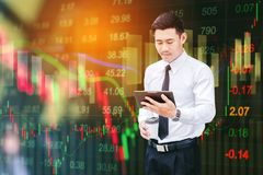 Businessman using digital tablet on digital stock market financi. Al exchange information and trading graph background Royalty Free Stock Images
