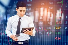 Businessman using digital tablet on digital stock market financi. Al exchange information and trading graph background Royalty Free Stock Photo