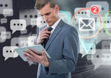 Businessman using digital tablet with digitally generated message and mail icon Royalty Free Stock Photos