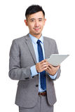 Businessman using digital tablet Royalty Free Stock Image