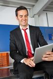 Businessman Using Digital Tablet In Laundry Royalty Free Stock Photo