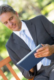 Businessman using digital tablet Royalty Free Stock Images