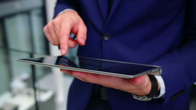 Businessman using digital tablet in office stock footage