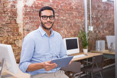 Businessman using digital tablet in office Stock Photography