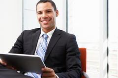 Businessman Using Digital Tablet In Office Stock Photos