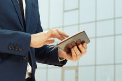 Businessman using a digital tablet outdoors Stock Photography