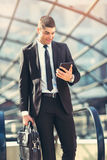 Businessman using a digital tablet outside of an office building Royalty Free Stock Photos