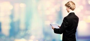 Businessman using a digital tablet Stock Images