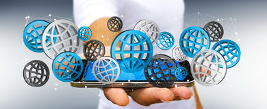 Businessman using digital web icons '3D rendering'. Businessman using digital web icons over his mobile phone '3D rendering Stock Images