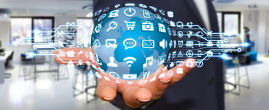 Businessman using digital world with web icons. Businessman holding digital web earth with modern icons Royalty Free Stock Images