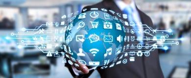 Businessman using digital world with web icons. Businessman holding digital web earth with modern icons Royalty Free Stock Image