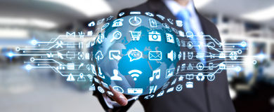 Businessman using digital world with web icons. Businessman holding digital web earth with modern icons Stock Images