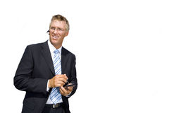 Businessman using electronic organiser, cut out Royalty Free Stock Photo
