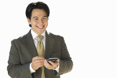 Businessman using electronic organiser, smiling, portrait, cut out Royalty Free Stock Image