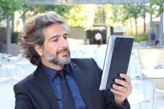 Businessman using electronic tab outside congress center Royalty Free Stock Photo