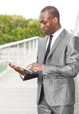 Businessman using electronic tablet Stock Photography