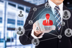 Businessman using finger for touch human icon. For CRM stock photography