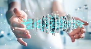 Businessman using floating modern gear mechanism 3D rendering. Businessman on blurred background using floating gear icons 3D rendering Royalty Free Stock Photography