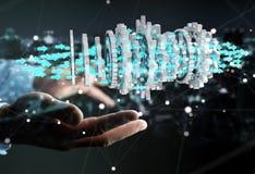 Businessman using floating modern gear mechanism 3D rendering. Businessman on blurred background using floating gear icons 3D rendering Royalty Free Stock Images
