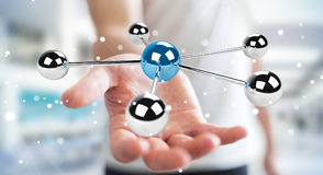 Businessman using flying 3D spheres network 3D rendering. Businessman on blurred background using flying 3D spheres network 3D rendering Royalty Free Stock Photos