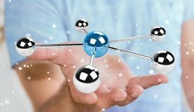 Businessman using flying 3D spheres network 3D rendering. Businessman on blurred background using flying 3D spheres network 3D rendering Royalty Free Stock Photo